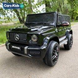 Электромобиль Mercedes-Benz AMG G63 K999KK черный (колеса резина, кресло кожа, пульт, музыка)